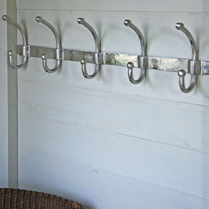 Row of five aluminium wall mounted coat hooks