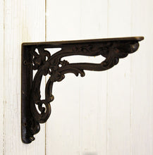 Victorian antique style floral iron shelf bracket.