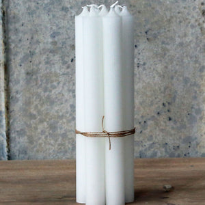 Tied bundle seven handmade Danish white dinner candles