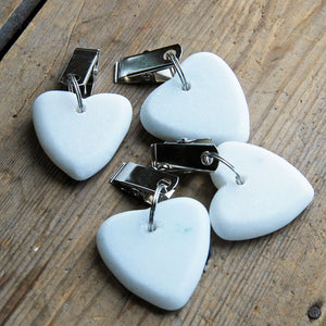 Set of four white heart shaped stone table cloth weights