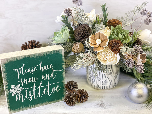 Pine and winter sola wood flower arrangement