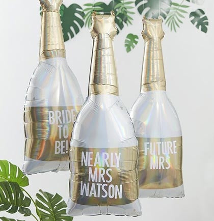 "This large 42"" gold and white champagne bottle shaped balloon is completely customizable! Customize it to your liking with the provided stickers for the bride."