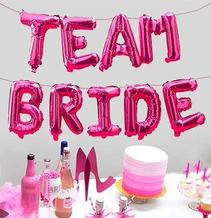 "Celebrate the bride letting her know you're on her team with these fun mylar balloons! These 16"" hot pink balloons spell out ""Team Bride"" and are perfect to decorate a wall, table or create a backdrop."