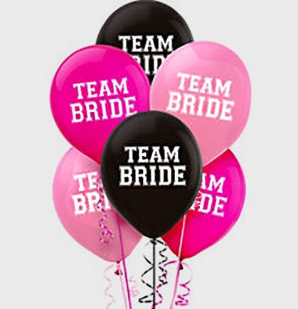 "Let everyone know you're celebrating your bride with these fun 12"" 'Team Bride' balloons! The pink and black balloons are a fun and inexpensive way to decorate the party."