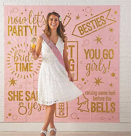 "Have fun talking selfies and other fun photos with the fabulous Last Fling Before The Ring giant backdrop. This 72""x72"" pink and gold backdrop is big enough to hang on the wall."