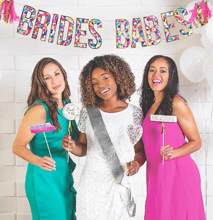 This banner is perfect for decorating a for an at home bachelorette party, hotel room or dressing up a table at a restaurant or bar. The six foot long letter banner says Brides Babes accented with tissue paper tassels on the ends.