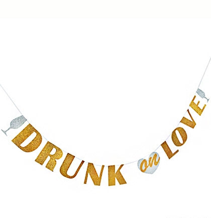 The paper letter banner is 5ft and says Drunk On Love accented with champagne glasses. Place it on a wall to decorate a room, or bring it with you to dress up a table at a restaurant or bar.