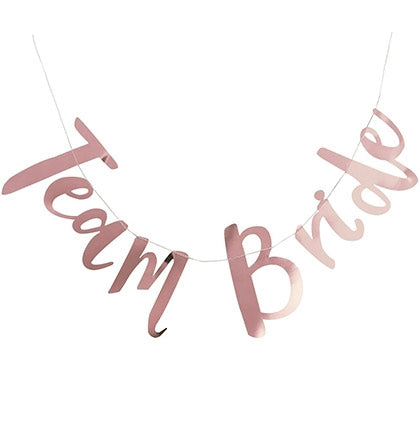 "Decorate the bachelorette party with this fun metallic banner! It's a great inexpensive way to add additional fun and ""pop"" to your party! The 5ft banner says Team Bride in a pretty rose gold."