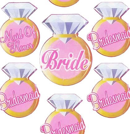 "This set of 7 bridal party pins is a sweet accessory for the wedding party. Have them wear these party buttons to the rehearsal dinner or bridal shower identifying who they are. The ring shaped button set includes 1 ""Bride"" button, 5 ""Bridesmaid"" buttons and 1 ""Maid of Honor"" button."