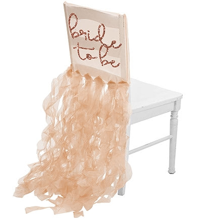 Our delicate rose gold glitter BRIDE TO BE organza chair cover is the perfect gift. The sheer white organza chair cover will have the bride be the center of attention.