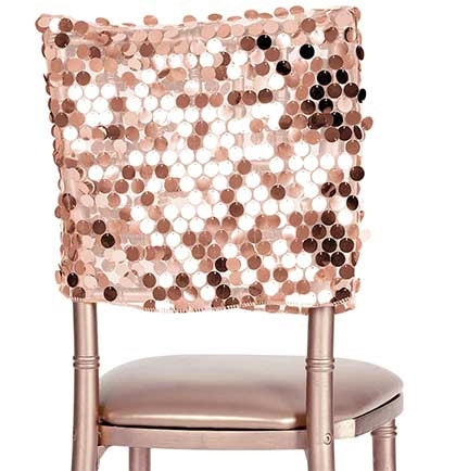 The perfect way to add some glitz and glam to the bachelorette party is with this Rose Gold Payette Chair Cap! Made of shiny rose gold payette sequins on mesh, the chair cap will add the sparkle you're looking for.