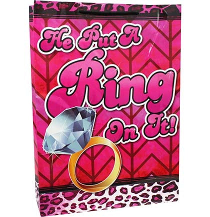 This jumbo gift bag is perfect to gift the bride at the bachelorette party or bridal shower. This fun bag says He Put A Ring On it and features an animal print motif with a diamond ring!