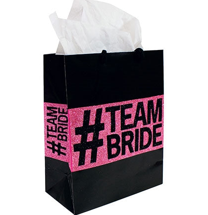 This fun and trendy paper gift bag is perfect to create goodie bags for the bridal party at the bachelorette party. The medium sized bag says #TEAM BRIDE in a glossy black and pink glitter.