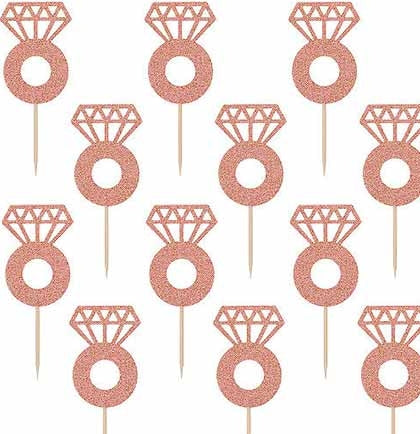 These 24pc rose gold glitter cupcake toppers are the perfect touch for a bachelorette party or bridal shower dessert table!