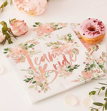 The hottest bachelorette party trend is a pretty floral with rose gold. These ivory napkins have metallic rose gold lettering accented with floral flowers. These luncheon sized Team Bride napkins are perfect for bachelorette party or bridal shower.