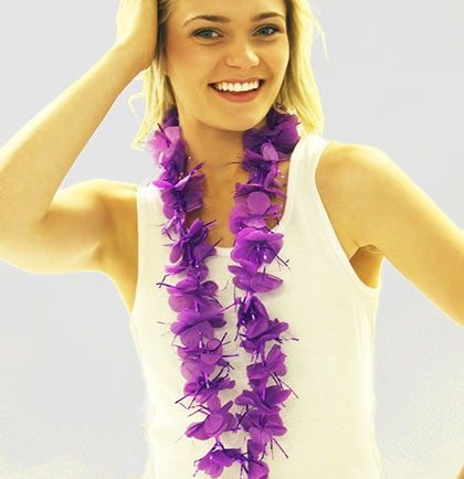 "This purple sparkly lei will have the guest standing out at the party. The fabric and tinsel lei is 30"" around and is an easy way to get the girls matching at a Tropical themed Bachelorette Party."