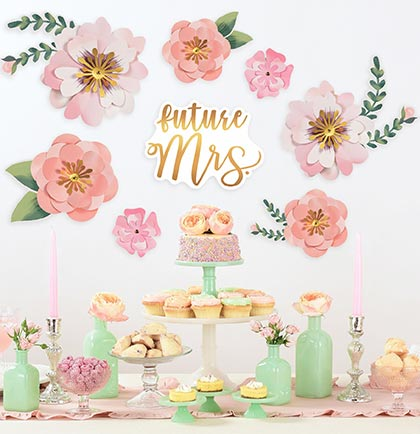Create a backdrop for a bachelorette party or bridal shower with these gorgeous Floral Cutouts. The set includes eight pieces the hang against a wall behind a party table. The set includes one Future Mrs. and seven different flowers.