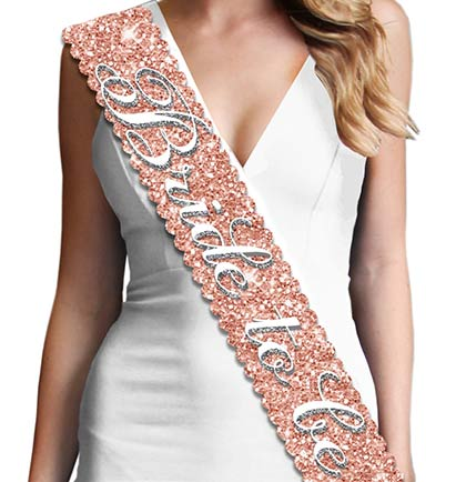 Show off at the bridal shower or bachelorette party with this scalloped edge sparkly BRIDE TO BE sash! The perfect keepsake to put in a memento box. Made with a sparkle fabric that is smooth satin on the backside for a comfortable fit. The sparkle on this sash doesn't shed!