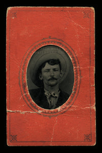 antique 1800s tintype photo of curled mustache man, big cowboy hat fills frame