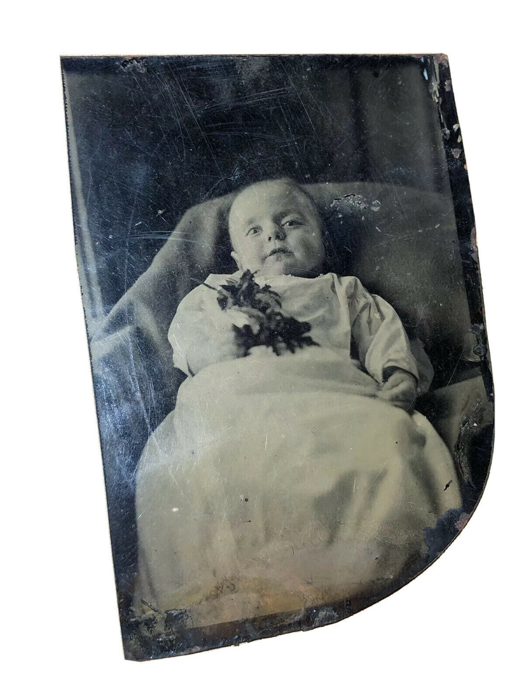 post mortem tintype child holding flowers / open eyes 1860s c1870