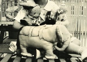 fire escape girl with toys black doll elephant & bird in cage! vintage snapshot photo