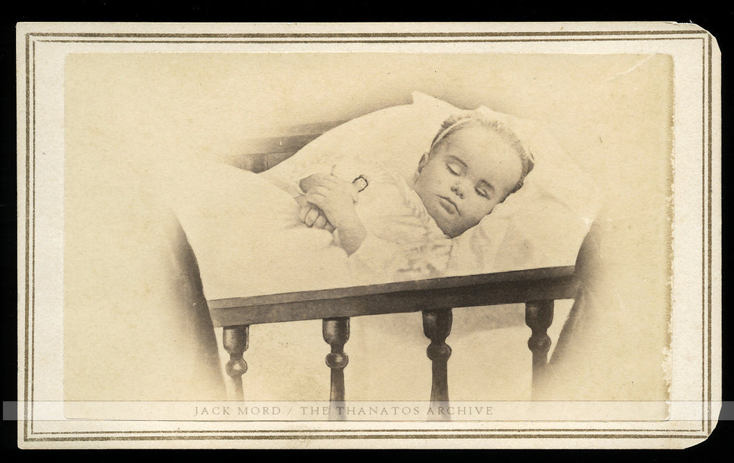 1860s Post Mortem Photo - Little Girl in Crib Holding Tiniest Doll
