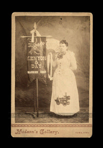 Machine Shop Banner Lady with Rare Fire Engine Pumper on Dress / Tama Iowa