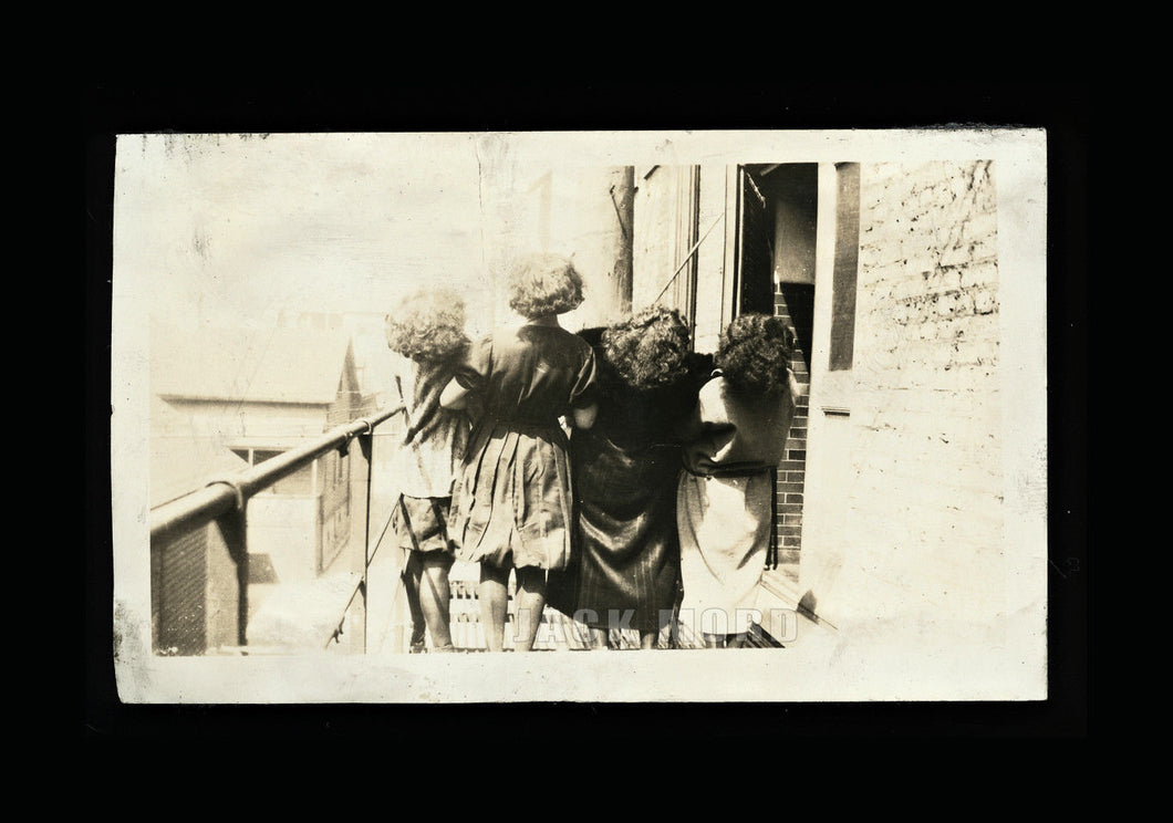 Unusual vintage / antique snapshot photo group of girls facing away from camera