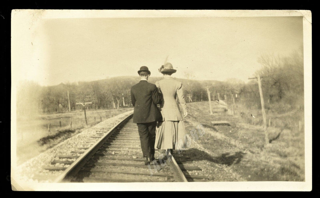 man & woman on train tracks back to photographer ~ artistic old snapshot photo