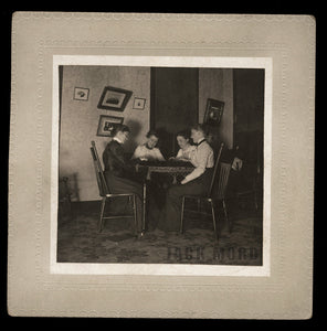 antique photo women in creepy victorian parlor halloween seance or ouija board ?