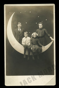 Family Sitting on Paper / Prop Moon - Vintage Photo RPPC