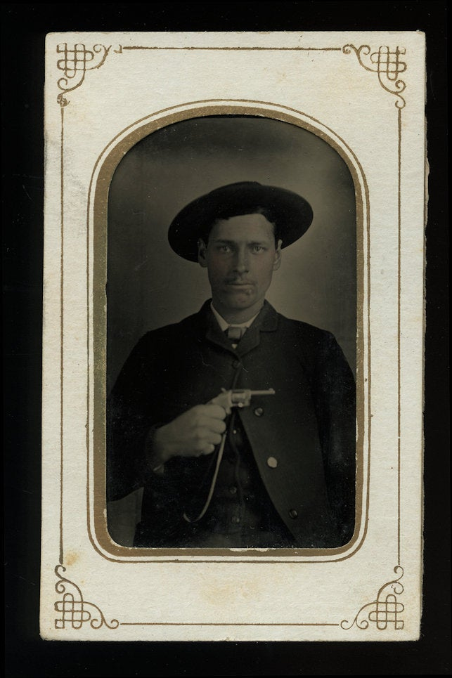 Western Man Holding Gun - Antique 1870s Tintype Photo