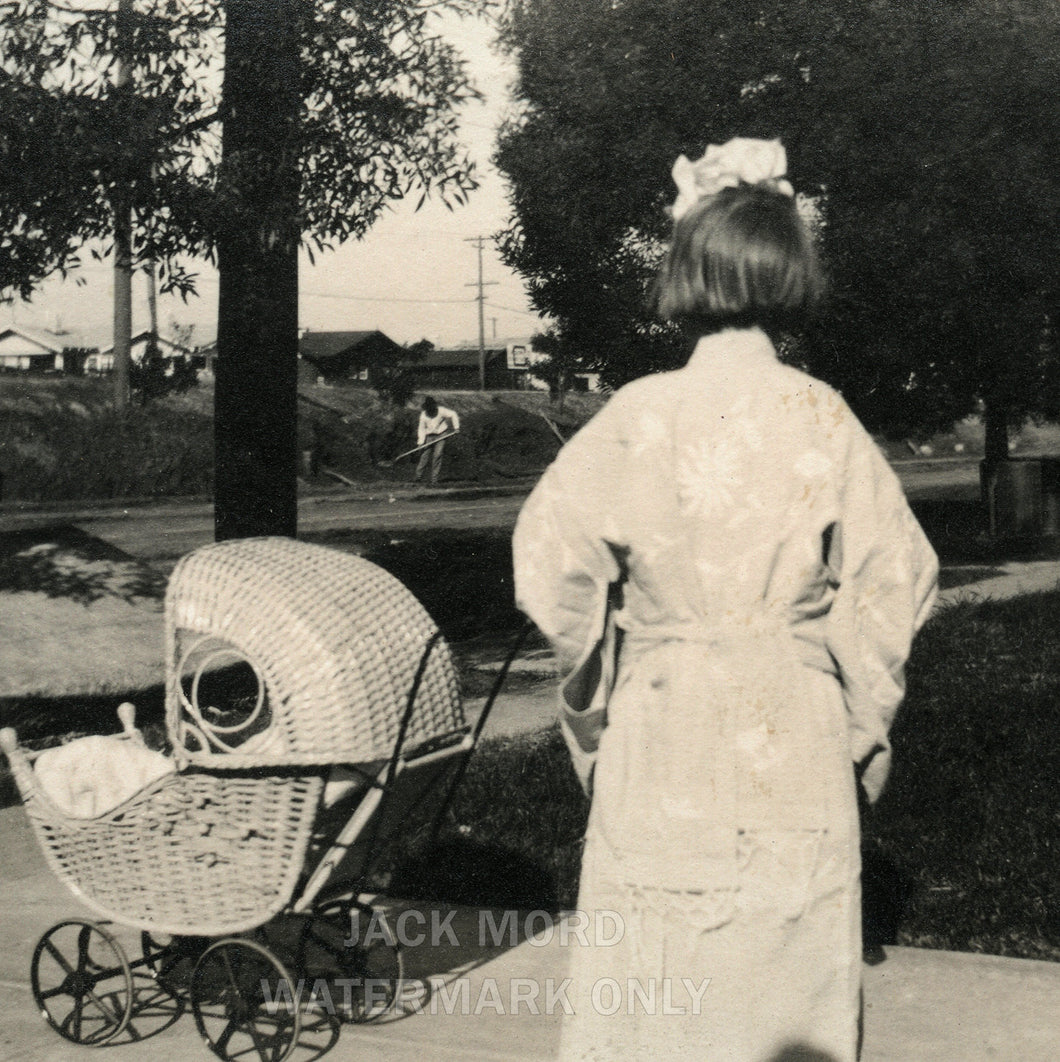 snapshot photo girl turned away from camera with doll stroller, unusual creepy
