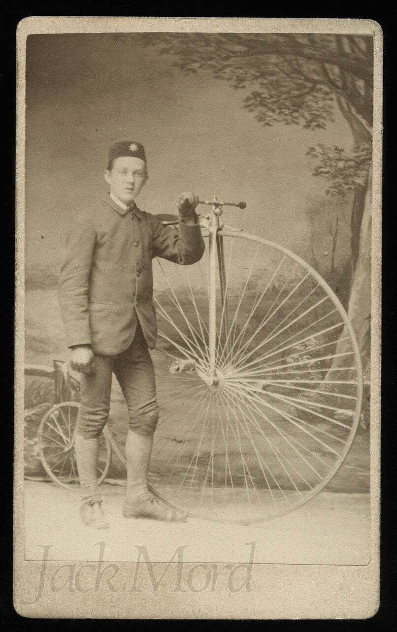 antique cdv man w star badge on hat posing w high wheel penny farthing bicycle