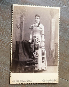amazing photo lady with cabinet photos pinned to dress! photographer advertising