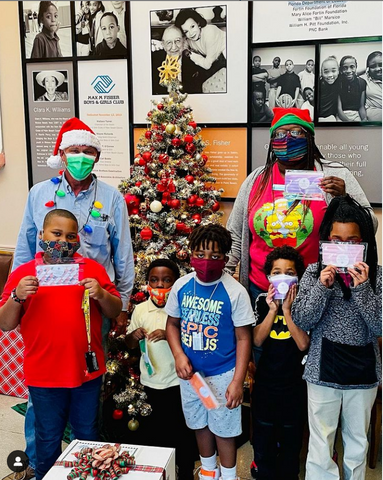 palm beach boys an girls club with chrismas tree and colored disposable masks from palm beach mask