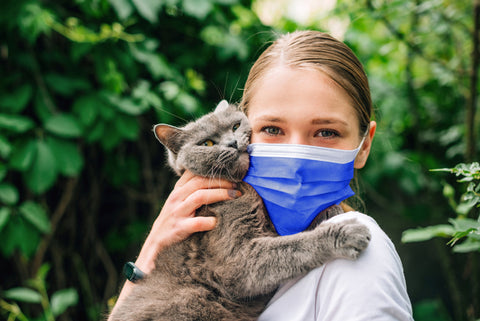 Blue disposable mask girl with cat