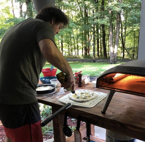 Chris Hill makes pizza