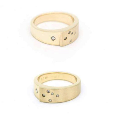 This custom made gent's wedding band features 0.05ct princess cut diamond and five round brilliant cut diamonds set in yellow gold with combination finish (one side has a matt finish, and the other one is mirror polished)