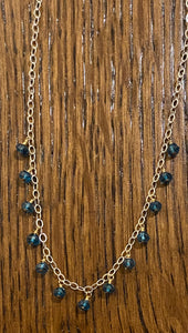 London blue topaz, silver, and gold necklace