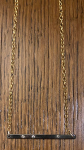 Silver, gold, and cubic zirconia necklace