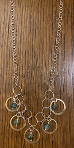 Emerald, silver, and gold necklace