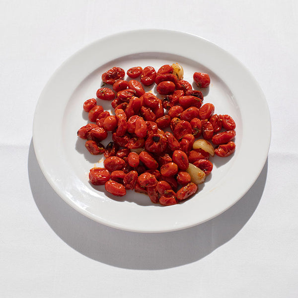 Small datterini tomatoes roasted with garlic.