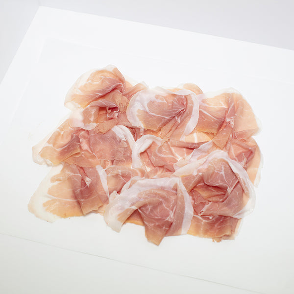 Thinly sliced Prosciutto on wax paper