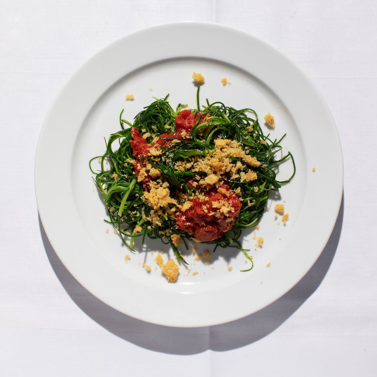 Agretti with Slow-cooked Tomato and Pangrattato