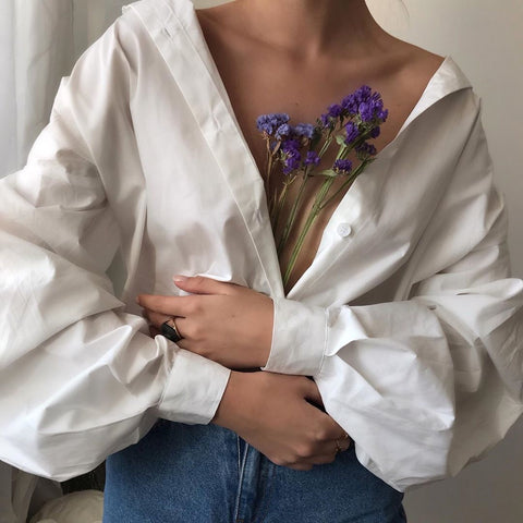 girl-in-jeans-and white-shirt-holding-lavander-with-her-arms-crossed