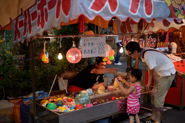 Tanabata vendor selling a toy at Tanabata Festival in Japan