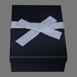 Charcoal box, gray tissue paper, gray cloth ribbon
