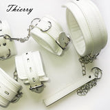BDSM white leather collar and handcuffs