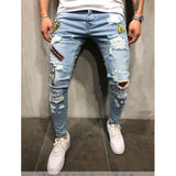 Ripped Jeans with Patches Distressed